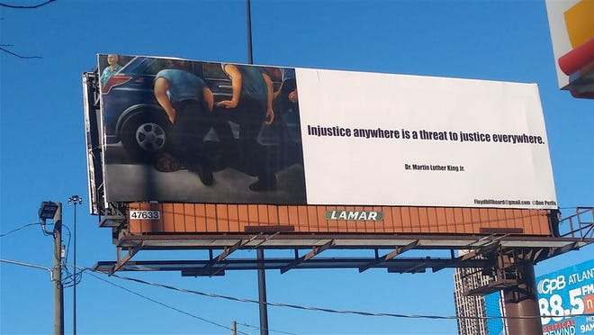The George Floyd Justice Billboard Committee has placed billboards featuring an artist rendering of George Floyd's death and a quote from Dr.  Martin Luther King Jr. was included in major cities across the United States, including this one in Atlanta.