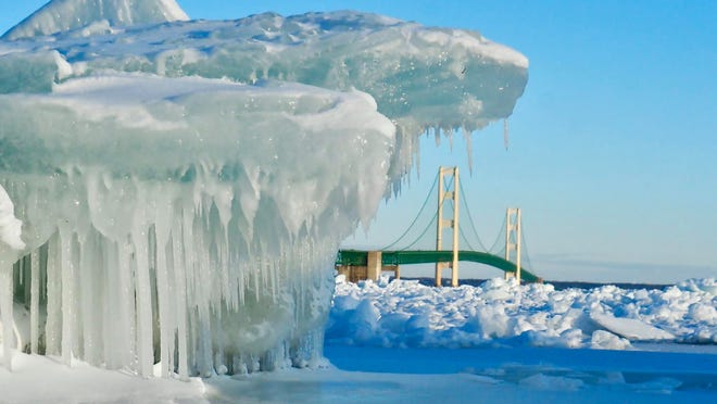 Glittering blue ice draws many to Michigan's Straits of Mackinac