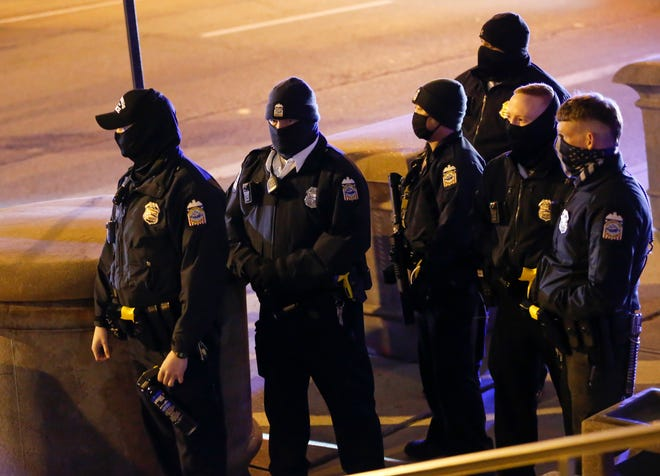 Following death of 16-year-old Ma'Khia Bryant in a Columbus Police-involved shooting, Columbus Police stands with pepper spray at the ready as protesters gather outside Columbus Police Headquarters in downtown Columbus, Ohio, on April 20, 2021.