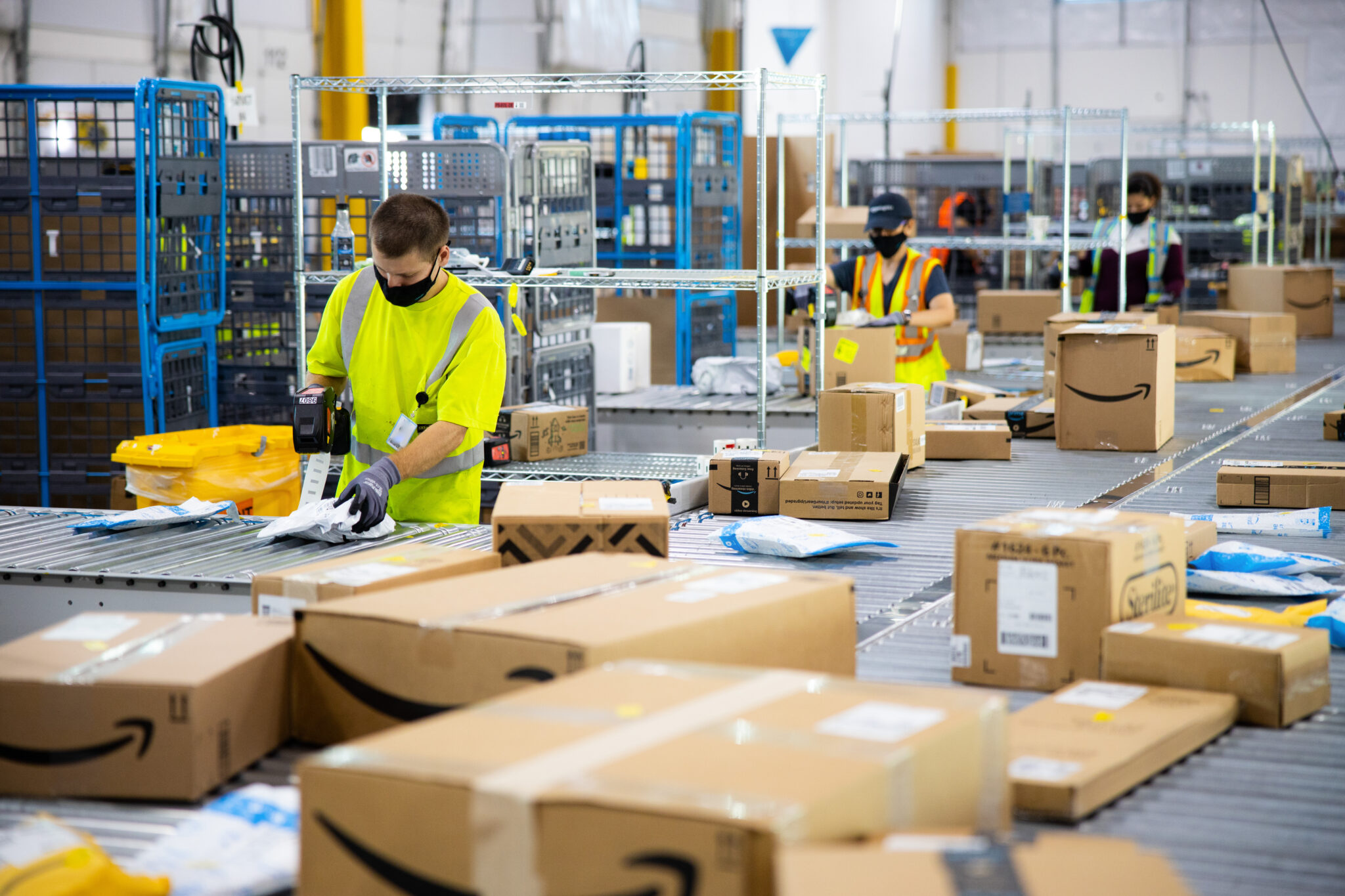 Washington state regulators say Amazon's workflow and pace injures warehouse workers