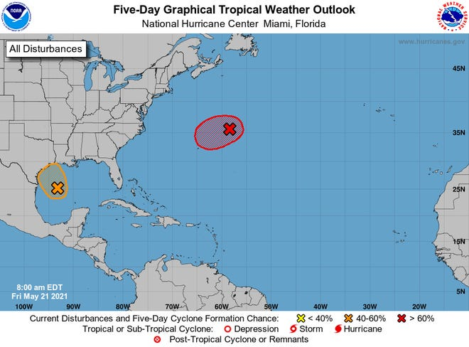 Two separate storms could form the next day in the Atlantic Ocean (in red) and the Gulf of Mexico (in orange), the National Hurricane Center said.