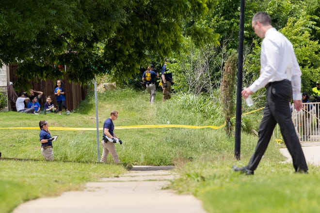 Dallas police and members of the FBI are investigating the scene near the location where a toddler was found dead with multiple wounds in the Mountain Creek area of Dallas on Saturday, May 15, 2021.  (Juan Figueroa / The Dallas Morning News via AP)