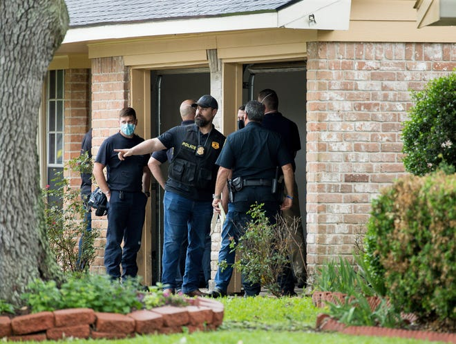 Police officers are investigating the site of a people smuggling site that found more than 90 undocumented immigrants in a house on the 12200 block of Chessington Drive in Houston on Friday, April 30, 2021.  A Houston Police officer said the case is being processed by federal authorities.