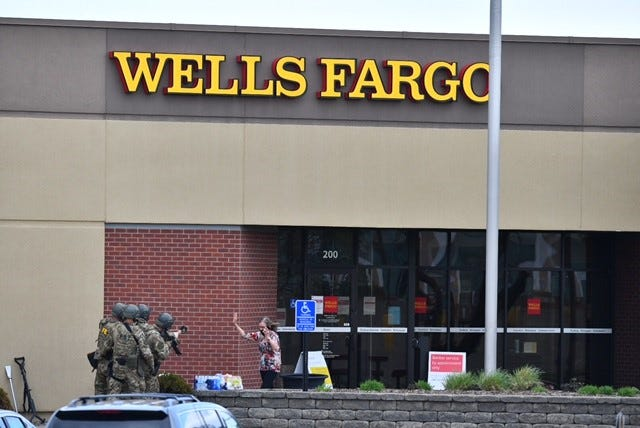 The first female hostage comes from the Wells Fargo bank building where she was held for hours, St. Cloud police said.