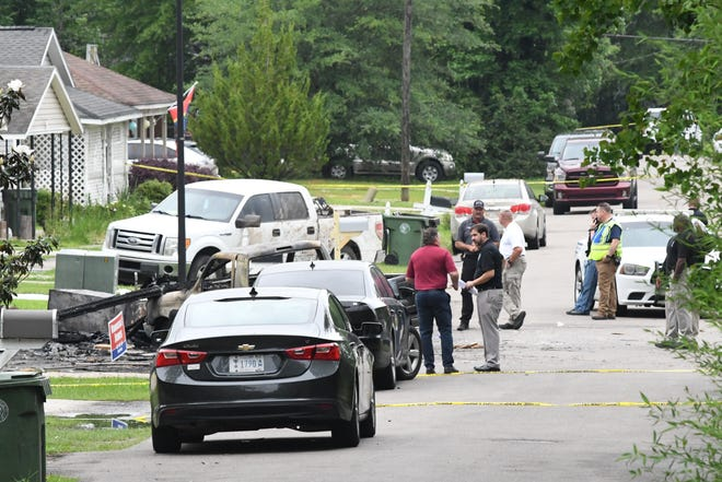 Rescue workers are investigating the location of a plane crash in Hattiesburg, Miss., On Wednesday May 5, 2021, which killed four people on Tuesday May 4, 2021.