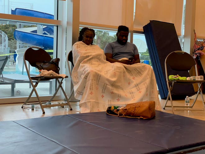 The American Red Cross established a reunion site for family and friends near the site of the partial collapse of a 12-story condominium in Surfside, Florida, early Thursday, June 24, 2021.  About 70 people crowded into a room with chairs and blue exercise mats on the floor.