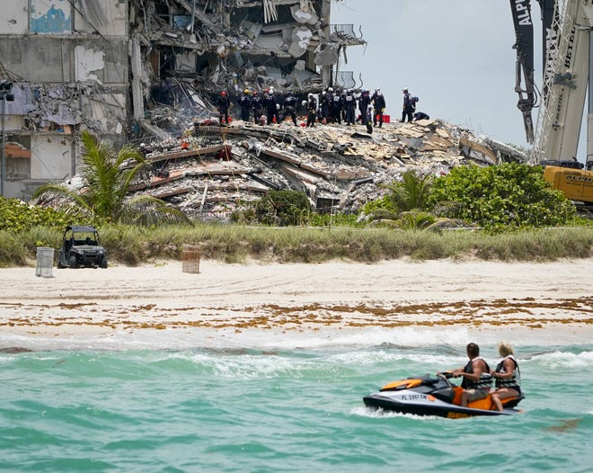 Search and Rescue crews continue to search for signs of life in the partially collapsed Champlain Towers South condo in Surfside, Florida Saturday June 26, 2021.