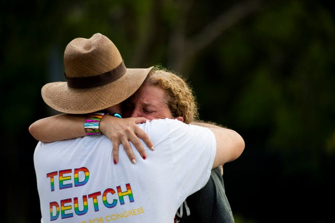 United States MPs Debbie Wasserman Schultz and Ted Deutch embrace after a truck crashes into a crowd during a Pride parade at Wilton Manors, near Fort Lauderdale on Saturday.