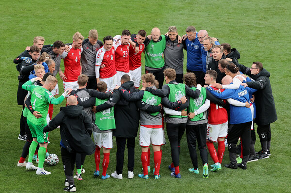 Denmark players and staff members huddled before play resumed.
