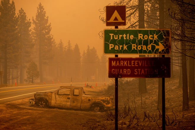The Tamarack Fire left a burned car on the side of the road in the Markleeville community of Alpine County, California on July 17.