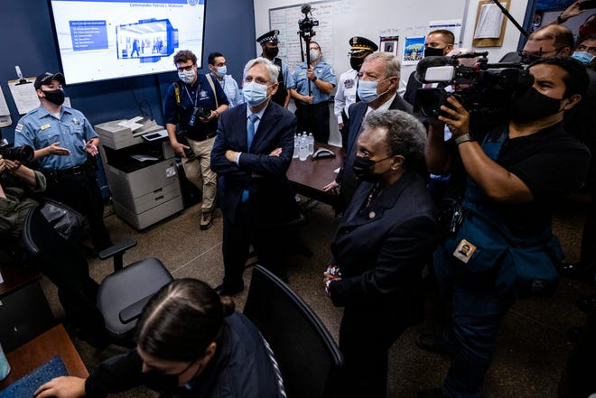 U.S. Attorney General Merrick Garland listens to a presentation with Senator Dick Durbin (D-IL) and Chicago Mayor Lori Lightfoot while he is at the Chicago Police Department's Strategic Decision Support Center in Chicago, Illinois on July 22, 2021 , visited.