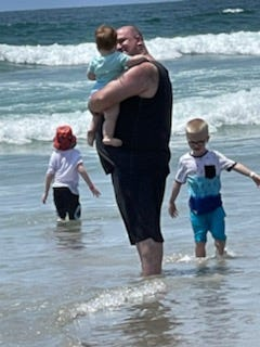 Freedy and three of his five children spend time on the beach during a trip to San Diego, California.