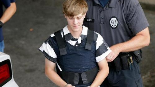 Dylann Storm Roof is escorted from the Cleveland County Courthouse in Shelby, NC on June 18, 2015.  Roof is a suspect in the shooting of several people at the historic Emanuel African Methodist Episcopal Church in Charleston.