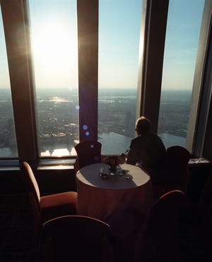 An unidentified patron looks at the 50-mile view from the Windows on the World restaurant atop tower 1 of the World Trade Center in New York Wednesday, June 26, 1996.