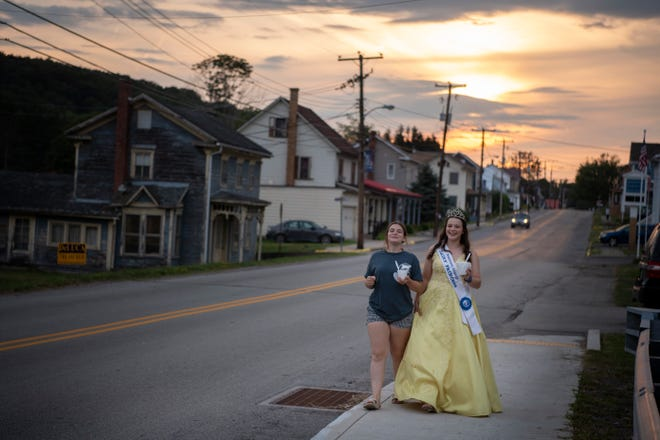 (Right) Kaitlyn Stoltzfus, Somerset County Dairy Princess, and her sister Abby, on Main Street in Shanksville, Pennsylvania, on Friday, August 6, 2021.